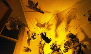 Paper-Birds-installation-in-yellow-light